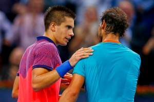 Coric after he has beaten Nadal in Basel October 24, 2014. REUTERS/Arnd Wiegmann.