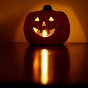 halloween-pumpkin-candle-with-burning-flame-600x600